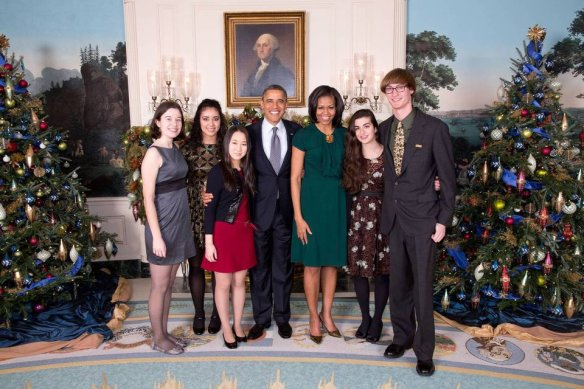 President Barack Obama and First Lady Michelle Obama greet the 2012 National Student Poets, Luisa Banchoff, Natalie Richardson, Claire Lee, Lylla Younes and Miles Hewitt in the Diplomatic Room of the White House following a Christmas holiday reception, Dec. 14, 2012. The First Lady is an Honorary Chairman for the PCAH. Official White House Photo by Lawrence Jackson. Courtesy of NSPP's Facebook page.