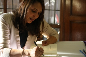 Pulitzer Prize winning poet Natasha Trethewey signs a copy of her book Native Guard at the University of Michigan. Photo courtesy of Jalissa Gray.